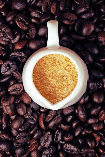 Coffee beans and sugar background
