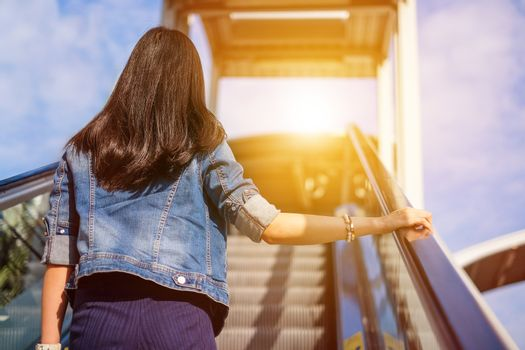 Young woman walking up stairs to reach her destination