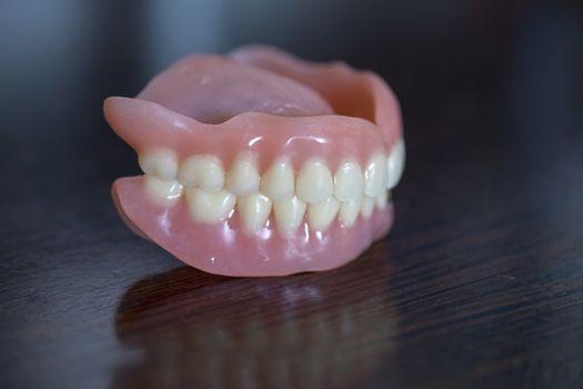 Medical denture set on table