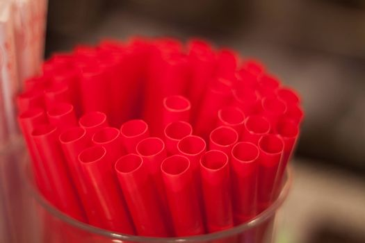 Red straws plastic drinking background, stock photo