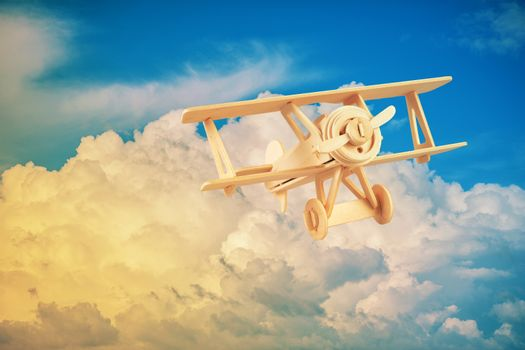 Wood airplane on the blue sky