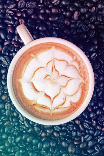 Capucino art coffee on Coffee beans background