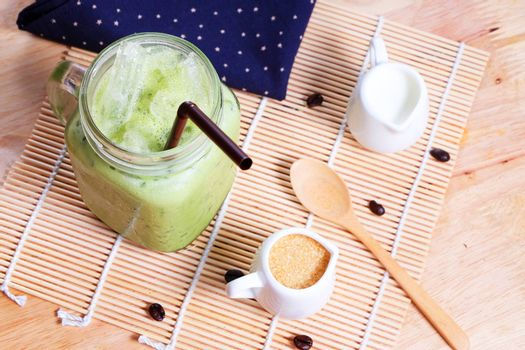 Green tea coffee on wooden texture table