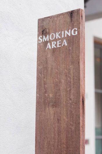 Smoking sign area on wooden plate, stock photo