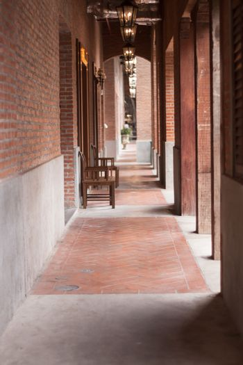 Walkway along the red brick wall, stock photo
