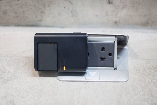 Charging battery on the floor, stock photo