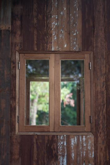 Wooden window frame on backyard, stock photo