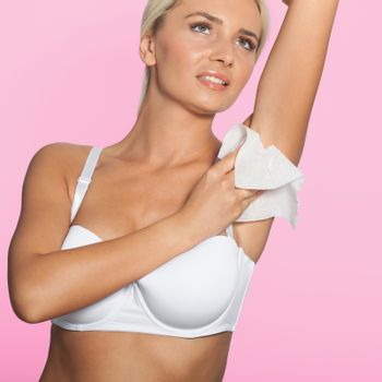 Woman cleaning the armpit with wet wipes