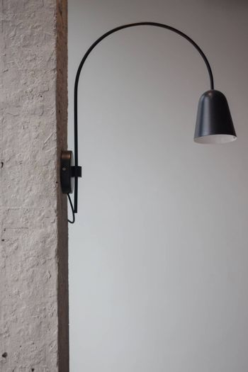 Metal lighting lamp on the wall, stock photo
