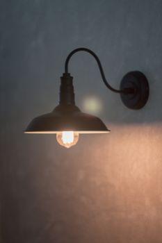 Metal lighting lamp on the wall, stock photo