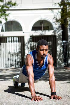 Happy athlete doing push-ups
