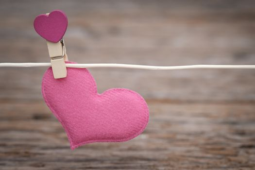Heart clothespin on the clothesline  with space to write. Valentine concept, Vintage tone, AF point selection.