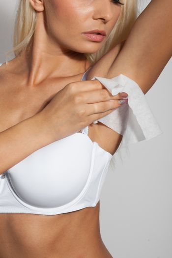 Woman use wet wipes to clean armpit