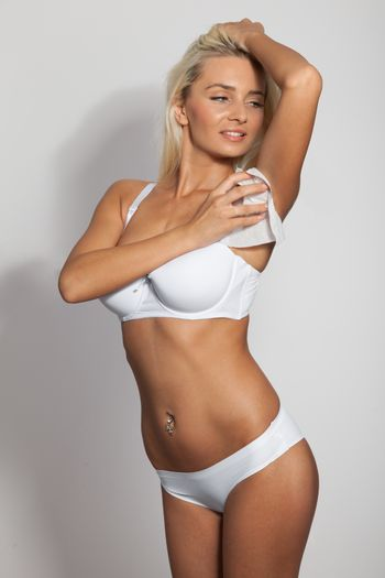 Sexy woman wipes the armpit with wet wipes