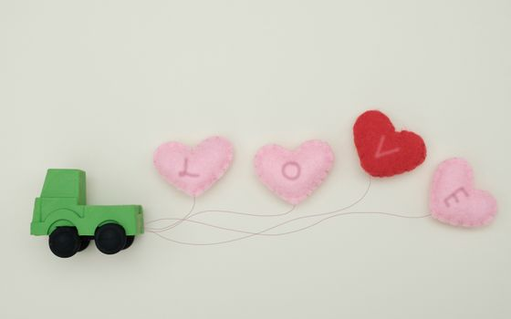 Toy car carrying heart-shape balloon, Concept of valentine day.
