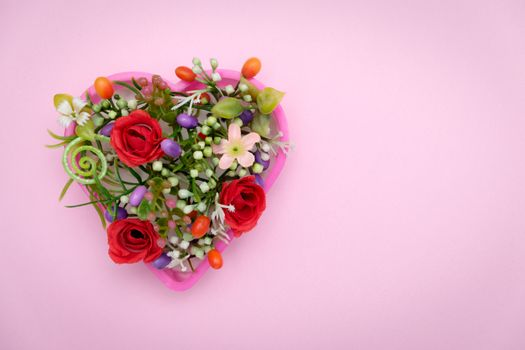 The flowers are in a heart shaped pot, valentine concept.