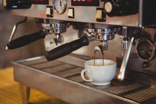 Machine making a cup of coffee