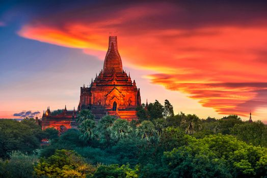 Landscape image of Ancient pagoda at sunset in Bagan, Myanmar.
