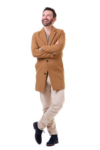 Full body happy man with jacket against isolated white background
