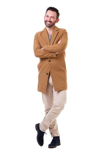 Full body happy man with coat standing against white background