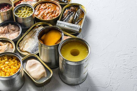 Tin cans for processed food cans conserve Saury, mackerel, sprats, sardines, pilchard, squid, tuna pinapple, corn, peas, mango , beans, over white textured background close up side view space for text