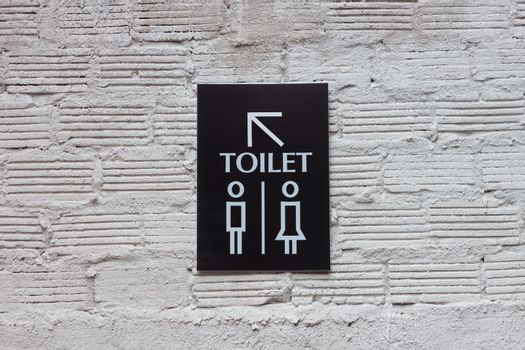 Toilet signs on white wall background, stock photo