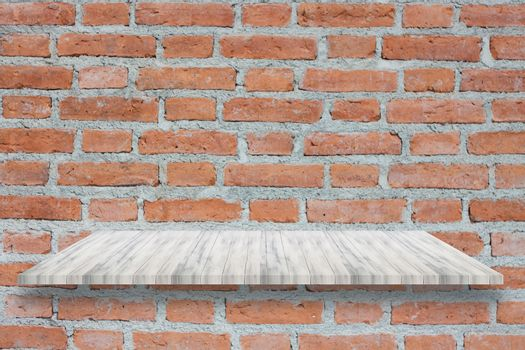 Top of white wooden shelf on brick wall. For product display