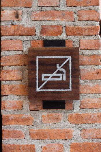 NO smoking sign on brick wall, stock photo