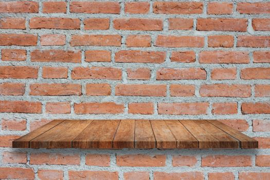 Top of broen wooden shelf on old brick wall. For product display