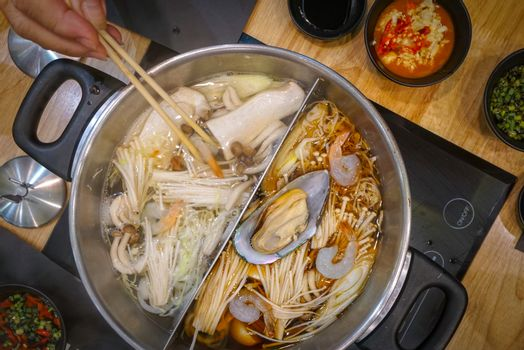 Sukiyaki a Japanese hotpot dish of seafood and vegetables boiled in water.