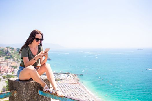 Young woman in background of mediterranean sea and sky.
