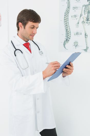 Doctor writing reports in the medical office