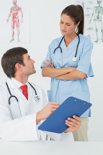 Doctors with reports in the medical office