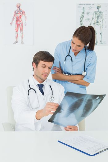 Doctors examining xray in a medical office