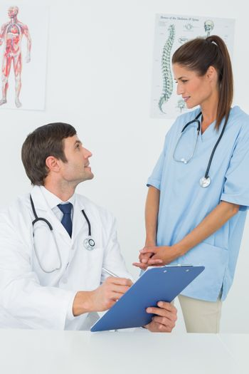 Doctors discussing reports in a medical office