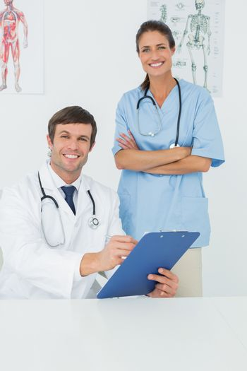 Doctors with reports in a medical office