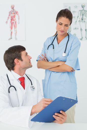 Doctors with reports in medical office