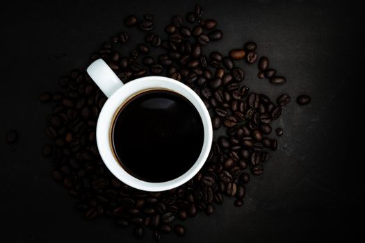 The Top view of Instant coffee in cup on dark background with beans and space for putting text