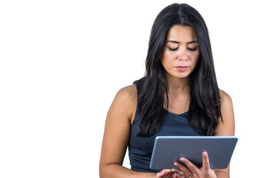 Concerned woman using her tablet
