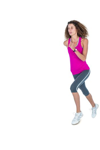 Determined young woman jogging