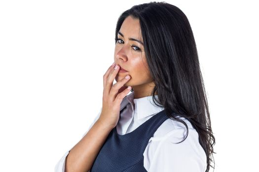 Woman deep in thought with hand on her chin