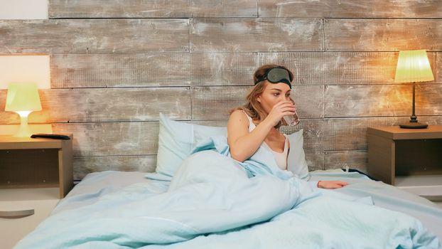 Beautiful woman pajamas waking up after a nightmare