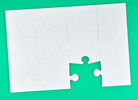 game of puzzles made of white paper pieces interconnected on a g