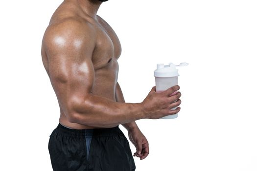 Muscular man with protein powder