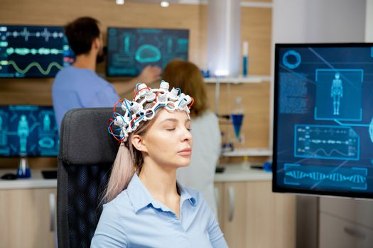 Female patient scanning her brain with neurology headset