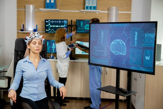 Patient who is brain scanned and his activity is seen on the big