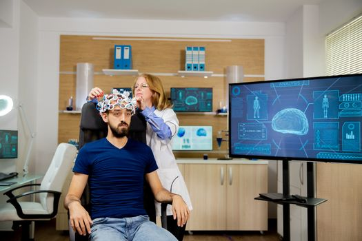 Patient who undergoes a brain scan procedure in a neurological center