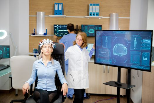 Doctor tracking patient evolution during neurology headset test