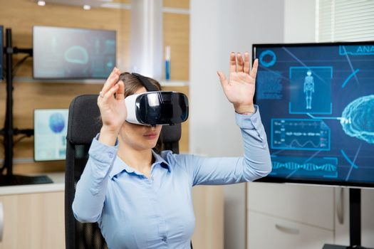 Female student learns neurology with vr glasses in futuristic la