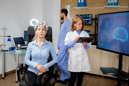 Doctor following the procedure of scanning a girl's brain
